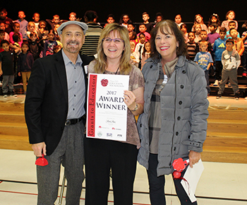 TAFF the Andrea-Mennon Foundation present grant to Jackson Music Teacher Linda Davis